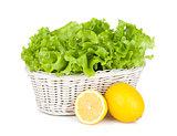 Lettuce in basket and lemons