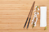 Chopsticks and sakura branch