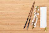 Chopsticks and sakura branch