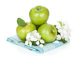 Ripe green apples and flowers