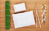 Empty plates, chopsticks and sakura branch