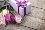 Fresh tulips with gift box