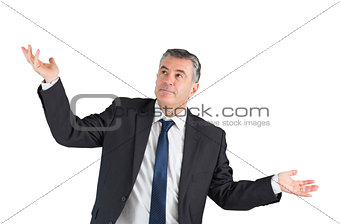 Mature businessman standing with arms out