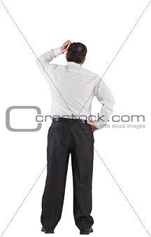 Mature businessman standing scratching head