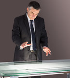 Concentrating businessman looking at desk