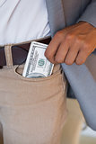 Dodgy businessman pocketing wad of dollars