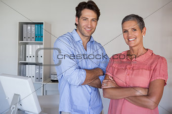 Casual confident business team smiling at camera