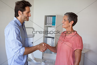 Casual smiling business people shaking hands