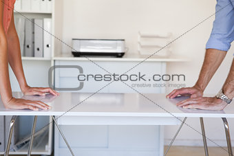 Business partners facing off at desk