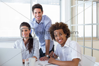 Casual workers smiling to camera