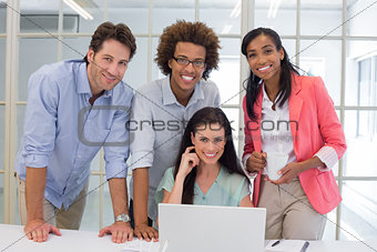 Four workers smiling to camera
