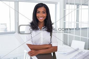 Pretty architect smiling to camera