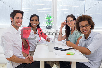 Casual workers meeting at table