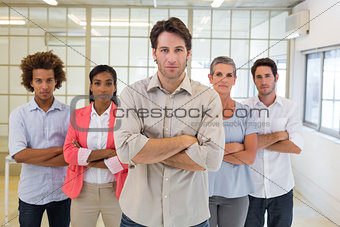 Boss and employees looking at camera