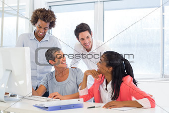 Casual workers smiling and discussing