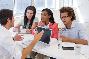 Four coworkers having a discussion
