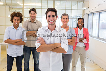 Workers with arms folded and smiling at camera