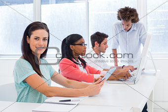 Casual business people working at desk