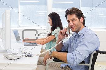 Businessman in wheelchair on telephone