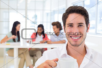 Casual businessman drinking hot beverage