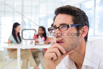 Casual businessman with glasses concentrating