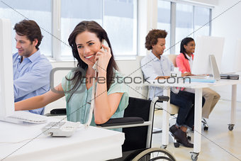 Businesswoman in wheelchair on phone