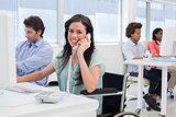 Attractive businesswoman in wheelchair on phone