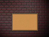 Cork board on brick wall