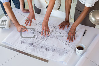 Architects looking at building plans carefully