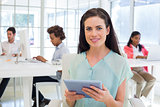 Attractive businesswoman with tablet pc