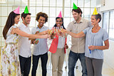 Coworkers celebrate success with champagne and a party