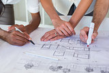 Architects drawing on the blueprints