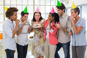 Workers celebrating a birthday together