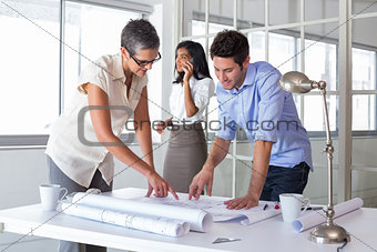 Architects looking at important blueprints