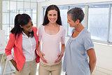 Attractive pregnant businesswoman at work