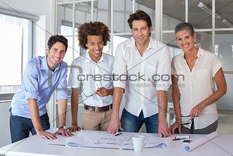 Team of architects smiling at camera