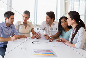 Attractive business people discussing at a meeting