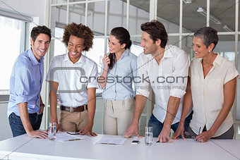 Casual business team having a meeting standing
