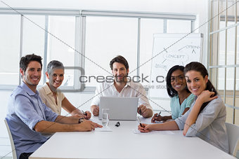 Attractive business people smiling at the camera