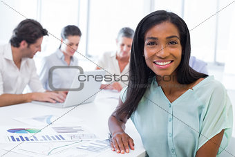 Attractive businesswoman smiling in the workplace