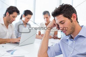 Attractive businessman resting at work