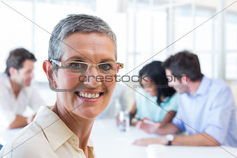 Happy businesswoman smiling at the camera