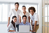 Attractive business people smiling in the workplace