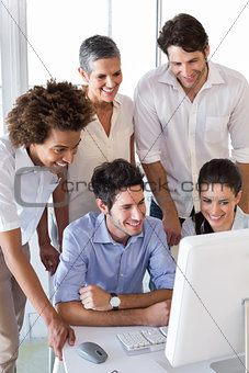 Attractive business people working hard on computer