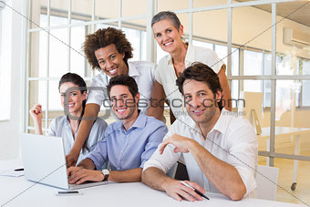 Business people using laptop smile to camera
