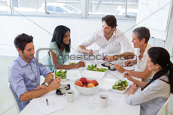 Business people eating lunch together