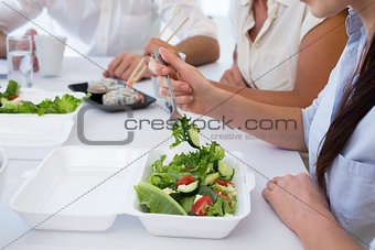 Business people enjoying salad and salad for lunch