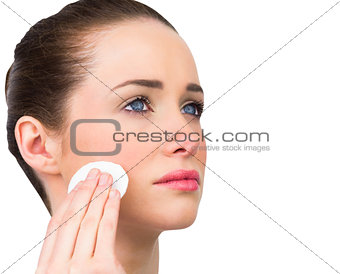 Natural beauty cleansing her face