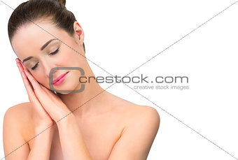 Natural beauty posing with hands to face