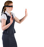 Redhead businesswoman in a blindfold